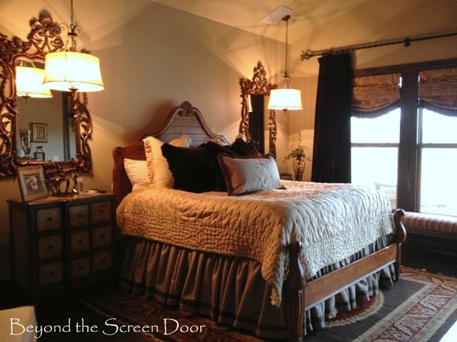 Dreamy master bedroom details beyond the screen door for Brown and cream bedroom