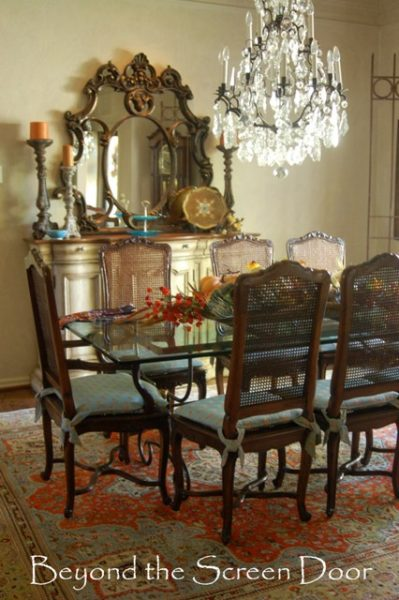 Things That Catch My Attention In Jans Dining Room Gorgeous Chandelier The Stunning Colors Her Rug Pairing Of Traditional Chairs With A