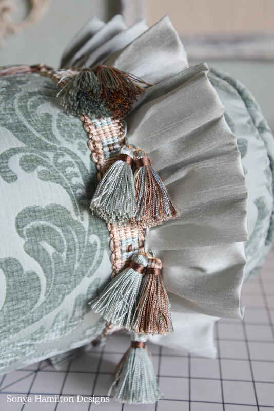 bolster pillow with tassels and ruffle